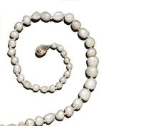 A pearl necklace with a topaz clasp