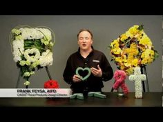 OASIS Floral Products Design Director Frank Feysa, AIFD, introduces new OASIS Floral Foam Shapes perfect for sympathy designing. The cross, heart and ribbon are all made with OASIS Floral Foam Maxlife for long flower life from the service to the gravesite.