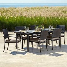 Take your meals outside with the new Portofino Sling Dining Table Set for a modern twist on outdoor furniture. Fully upholstered furniture is designer styled in all-weather platinum sling, giving a finished look to your contemporary outdoor environment. Outdoor Dining Set, Outdoor Living, Outdoor Furniture Sets, Outdoor Decor, Dining Furniture, Outdoor Ideas, Dining Arm Chair, Dining Table, Arm Chairs