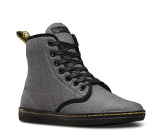 Named after London's hippest postcode, the Shoreditch boot is a relaxed, streetwear-influenced take on the classic Dr. Martens boot. And now, it comes in a casual-yet-refined twill canvas. Still, the women's boot serves up all the classic Doc's DNA: grooved sides, a yellow heel loop, and a yellow sidewall thread giving a nod to the traditional Dr. Martens yellow welt stitching. And of course, the boot sits on the riotously comfortable air-cushioned sole.
