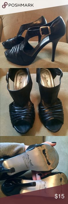 Black heels w/ silver buckle Like new. Only the bottoms of the shoes show wear. Shoes