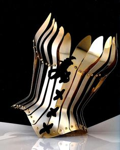 Thierry Mugler. Corporate Corset? Imagine being in the boardroom of the apprentice wearing this with your black slacks.