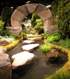 Meandering pond; the really interesting object is the megalithic-looking stone arch! This could be made of faux rock to create a very special garden like one an explorer might have found!