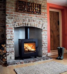 Wood Burning Stove - brick chimney with brick hearth Brick Fireplace, Brick Hearth, Wood Pellet Stoves, Fireplace Design, Exposed Brick, Woodburning Stove Fireplace, Red Brick Fireplaces, Painted Brick, Fireplace