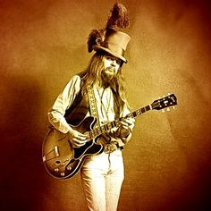 Leon Russell....still Glam but in a more singer/songwriter sort-of-way.