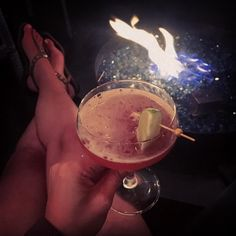 """{drinks by the fire} enjoying my """"Unfinished Monkey Business"""" - vanilla-mango rooibos infused vodka sureau liqueur cranberry & pineapple juices - at the Starlight Rooftop Lounge of @vesuviocarmel with @jimbarbato.  #fireside #drinkup #delicious #vesuvio #carmelbythesea #lifeisgood #goldencoast"""