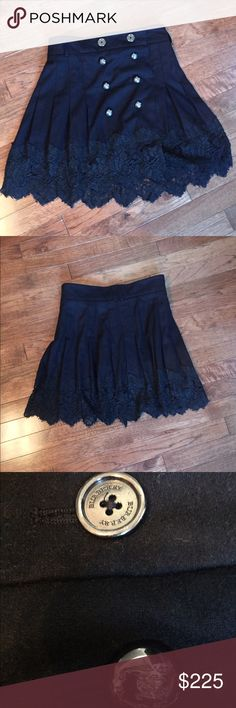 Burberry Black Wool & Lace Mini Skirt - 2 For when you feel like showing off your legs.💁 Amazing sz 2 pleated black wool super duper mini skirt by Burberry has beautiful black lace, silver buttons on the front and velcro, clasp and button closures to make sure it stays in place! It was worn but is still in really good condition. The buttons on one side do droop a little when worn, so this may be good for someone who isn't afraid to resew them back on tighter. 😊 Burberry Skirts Mini