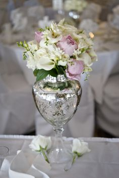 From Maggie's wedding -- I went around everywhere I could think of and bought Mercury glass vases of all shapes and sizes and did my center pieces for my wedding. It was more beautiful than I had imagined... Picture by McDowell Photography