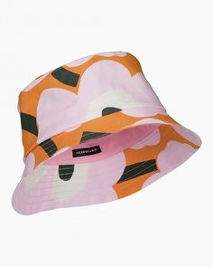 The Olema bucket hat has a topstitched brim with reinforcement that helps to keep it in shape. The hat is made of cotton with the orange, pink and dark green Pieni Unikko pattern, which is printed in Helsinki. Marimekko, Green Hats, Green Materials, Green Colors, Bag Accessories, Bucket Hat, Dark, Prints, Pattern
