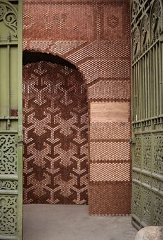 Innovative Surface Design by Giles Miller Studio. the entrance to Clerkenwell Design Week in the form of a timber archway made up of 20,000 angled wooden pixels.