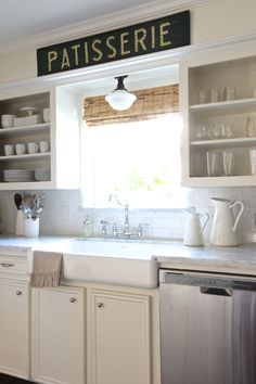 existing cabinets similar to ours redone - marble counters, crown molding, mini-farm sink. good refresh idea!