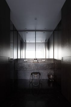 Potts Point Apartment by George Livissianis | Contemporary black bathroom with feature stool | Mono Luxe |