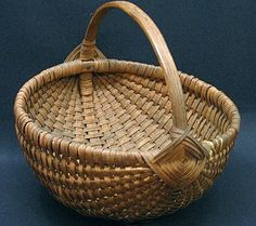 "Oak Splint, Nails and String. A wonderful Oak Splint Melon Basket with a nut brown aged Patina…In Mint Condition, there are two Oversized ""Flowers"" wrapped at each Handle…The Basket has Great Height and a Pleasing Form…A welcome addition to any Collection…This Basket was Found in South Eastern Pennsylvania…Ht 10 1/2 and the Diameter is 10 5/16""..          sold  325.00"
