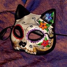 it's an awesome combination of two things I like - Venetian Masks and Sugar Skulls/Day of the Dead! :)