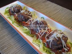 Cheesie Mega Meatballs - (combo of beef and pork) - uses ricotta, cream cheese in mixture - recipe for quick sauce included -  .38g net carbs for 2 mega naked meatballs, also carb counts served with sauce and zoodles! (zucchini noodles)