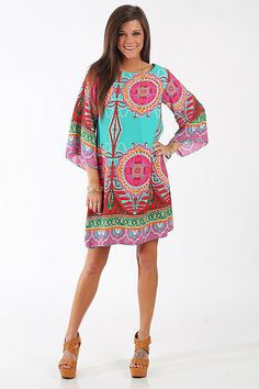 This dress is so bold and bright! The silky dress is just plain gorgeous!