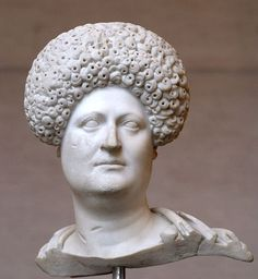 "Ancient Rome: Roman woman wearing a ""diadem"" wig that was fashionable at the time. At that time, popular hairstyles changed so quickly that women often had their statues made with removable hairpieces so that the hairstyle could easily be switched out."