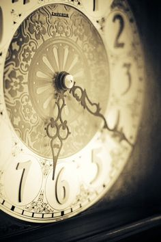Oooooh...that's a beautiful clock. I usually prefer skeleton clocks, but this one is great!