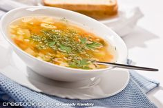 food: macro picture of soup with parsley