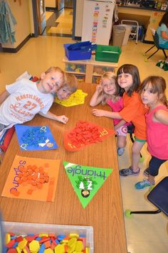 Create shaped paper backgrounds for sorting pattern blocks by shape.