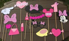 These adorable photo booth props will be the perfect touch to any party, capture memories for that special day! Sure To Make Everyone Love them! The listing is for 15 photo booth props. They are made of good quality card and premium cardstock and adhered into 10 wooden dowels. You will receive: 1 Minnie Mouse head 1 Bow 1 Minnie mouse glasses 1 Lip 1 minnie Shoe 1 necklace 1 pointing hand 1 lip gloss 1 nail polish 1 Minnie Mouse head 1 Minnie sign heart 1 Minnie Mouse image 1 #1 ( age of…