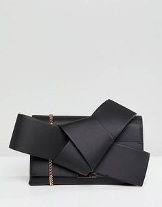Buy Ted Baker Giant Knot Clutch in Leather at ASOS. With free delivery and return options (Ts&Cs apply), online shopping has never been so easy. Get the latest trends with ASOS now. Leather Clutch Bags, Leather Handbags, Ted Baker Fashion, Ted Baker Bag, Oversized Clutch, Types Of Bag, Bonded Leather, Purses And Handbags, Ladies Handbags