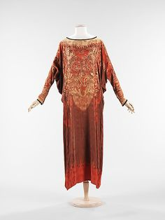 "Evening Dress: ca. 1920, American or European, silk. ""This evening dress is an example of the ongoing fascination with Eastern and Middle Eastern cultures that prevailed in the early 20th century. The garment itself reflects a mix of influences with its caftan shape, batik-style print, and use of Chinese motifs. The finishing details reflect a high level of quality and the use of batwing sleeves are an intriguing feature."""