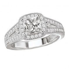 Halo Semi-Mount Diamond Ring $2,005 Style: 115047-100 Diamond Engagement Ring in 14kt White Gold with a Split Shank and Milgrain Detail. (D.3/8 carat total weight) This item is a SEMI-MOUNT and it comes with NO CENTER STONE as shown but it will accommodate a 5.5mm princess cut or 6mm cushion cut center stone.