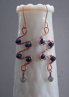 Looking for jewelry project inspiration? Check out Blue Crystal & Copper Wire-wrap Earrings by member Angel. - via @Craftsy
