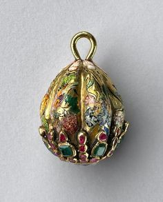 Elaborate 17th century Russian egg-shaped gold button, painted enamels with rubies and emeralds.