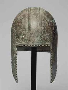 A GREEK BRONZE ILLYRIAN HELMET     									ARCHAIC PERIOD, CIRCA FIRST HALF OF THE 6TH CENTURY B.C.