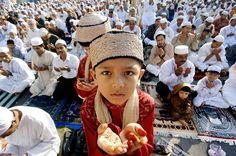 offer prayers as they kick off the Eid al-Fitr celebrations