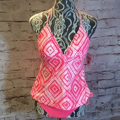 MIX IT UP TANKINI SET This is a mix match of 2 brands to make this fabulous TANKINI. Beautiful light and dark coral with white. Halter tie top with removable padded bust and bottoms are a crochet solid. They go perfectly together and are high quality MIXED Swim Bikinis