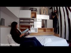 Paris micro-apartment stacks kitchen, bed, bath in 129 sq ft - YouTube.  Really thoughtfully designed tiny, tiny apartment.  Lots of good ideas.