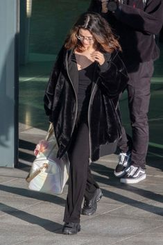 Selena Gomez Arrives at Heathrow Airport in London 12/02/2019. #selenagomez  #selenagomezstyle #celebrity #fashion #clothing #closet #celebrityfashion #celebritystyle #celebritystreetstyle #streetfashion #streetstyle