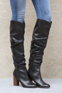 Slouchy black leather tall boots on a stacked block heel | Sole Society Bali