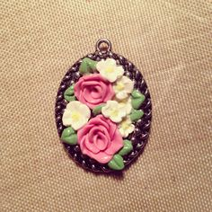 Floral cameo pendant handmade from polymer clay