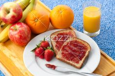 assorted healthy fruits - Assorted healthy fruits with slice bread and strawberries on a plate.