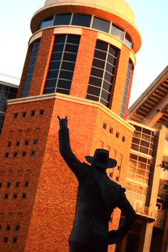 "The Etter-Harbin Alumni Center is across the street from the Stadium. In its courtyard are many statues, including one a Longhorn Band member doing the ""hook 'em horns"" and of Bevo standing proud. It is a common to see people climb up on Bevo for a great picture opportunity. The alumni center also provides a secluded spot to enjoy lunch or grab a quick snack in between class at the Texas Espresso Cafe that overlooks Waller Creek."