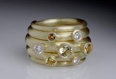 Mark Nuell, 18ct gold, yellow sapphires and diamonds