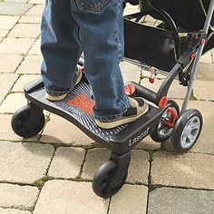 I saw a toddler riding on the back of a stroller on one of these roller boards. It looked like so much fun, and a good way to give the Bubs an alternative to riding *in* the stroller when he's tired out.