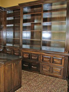 Grand LDK Home office with rich built-in cabinets and custom built desk.