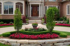 front yard landscape ideas symmetrical flower beds round centerpiece retaining wall
