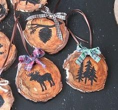 DIY Rustic Ornaments..You can either freehand your designs with a pencil, or use mini cookie cutters for stencils. Another idea is to google some north woods decorations and print out a few designs to use. You can even use black transfer paper to add the designs to the wood.: