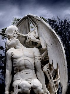 "the ""kiss of death"" statue at the old graveyard of poblenou in barcelona."