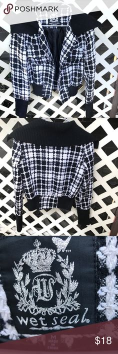 Wet Seal Back and White Plaid Jacket Wet Seal black and white plaid jacket. Size medium. This jacket is a quite heavy material. In good used condition. If you have any questions please don't hesitate to ask! Wet Seal Jackets & Coats