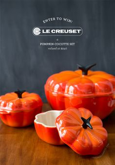 Le Creuset Pumpkin Cocotte Set.  If I had buckets'o'money, I would buy these in all 3 colors.