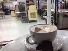 Five Essential Foodie Stops in Burlington, Vermont | Jaunted | pictured drink from Lake Champlain Chocolates with view of the chocolate being made!