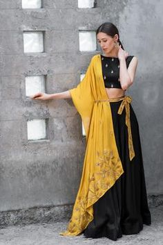 Black Drape Skirt With Mustard Jacket Indian Gowns Dresses, Indian Fashion Dresses, Indian Designer Outfits, Choli Designs, Lehenga Designs, Mode Outfits, Fashion Outfits, Women's Fashion, Navratri Dress