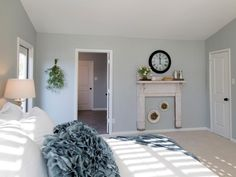 A bedroom fireplace adds instant warmth, but when it's too expensive to add the real thing, a shabby-chic faux fireplace may do the trick. This adorable example from HGTV's Fixer Upper proves it doesn't take big bucks to create a cozy space. Farmhouse Style Bedrooms, Shabby Chic Bedrooms, Cozy Bedroom, Modern Bedroom, Bedroom Wall, Bedroom Decor, Bedroom Ideas, White Bedroom, White Bedding